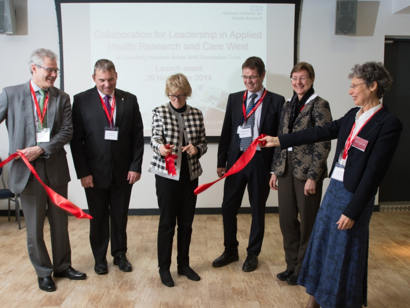 Professor Dame Sally Davies cuts the ribbon at the CLAHRC West launch